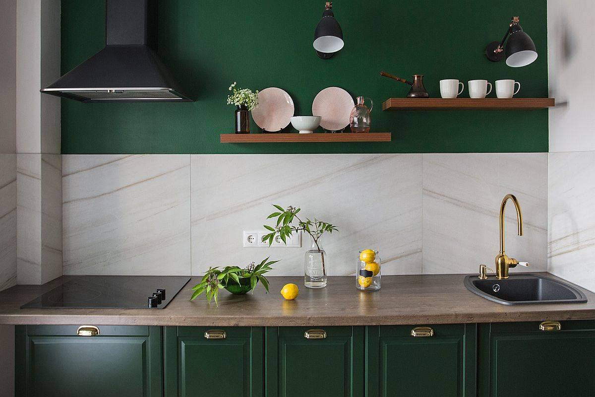 Exquisite deep green is combined with light beige in this small, single-wall urban kitchen
