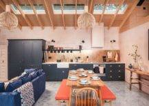 Eye-catching-Scandinavian-style-kitchen-with-light-pink-walls-brings-orange-to-the-setting-using-twin-benches-at-the-dining-table-74313-217x155