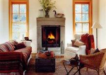 Fireplace-colors-of-the-throws-and-the-neutral-backdrop-give-this-modern-rustic-living-room-a-cozy-vibe-79571-217x155