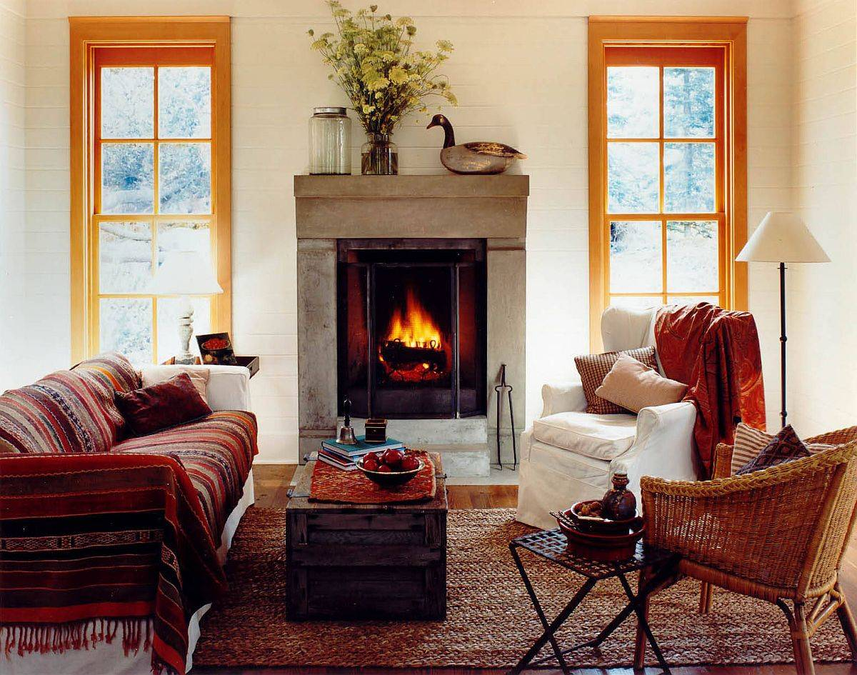 Fireplace, throws and rug shape this small yet comfy living room