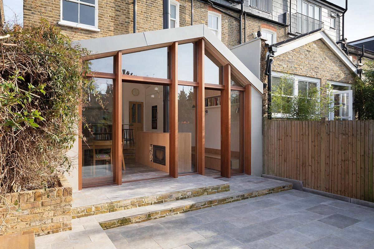 Glass-walls-open-up-the-interior-to-the-stone-clad-backyard-49505