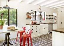 Gorgeous-Tuscan-style-eat-in-kitchen-finds-space-in-the-modest-room-with-a-small-table-and-a-couple-of-bright-red-bar-chairs-21067-217x155