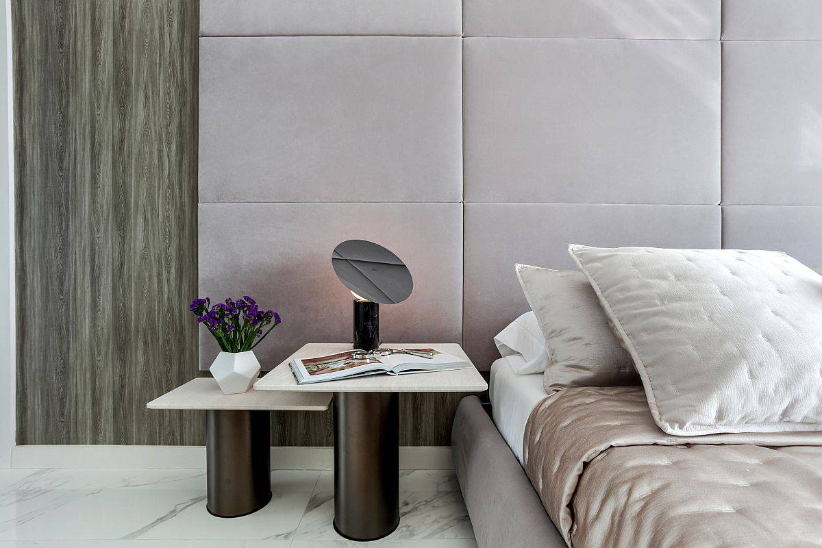 Gorgeous and luxurious modern bedroom with tufted walls and posh marble floor