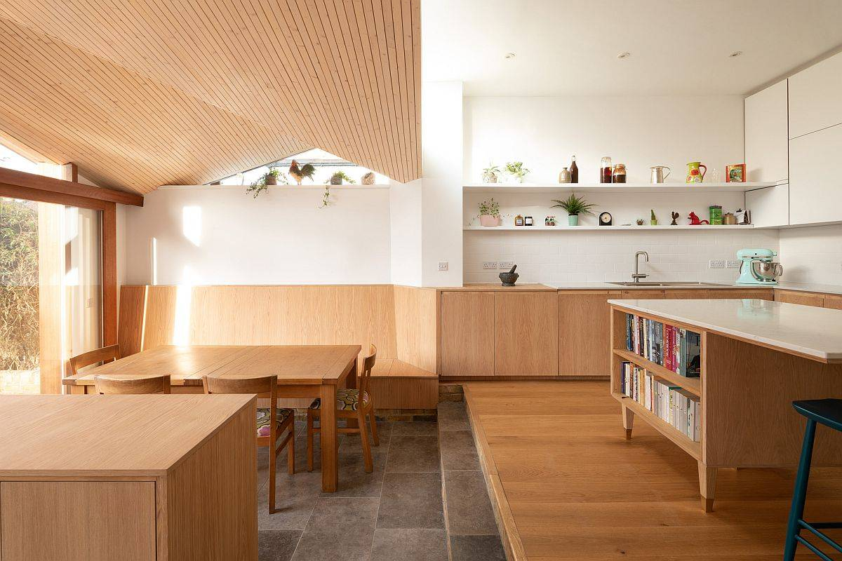 Gorgeous and pleasing extension in wood and white holds a dining area, kitchen and sitting space