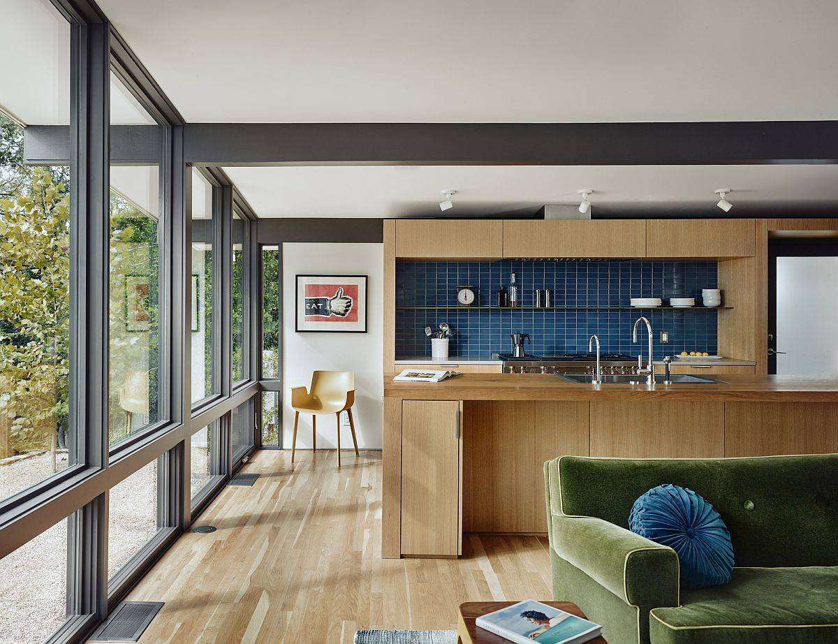 Gorgeous-blue-tiled-backsplash-steals-the-spotlight-in-this-modern-kitche-draped-in-wood-13703