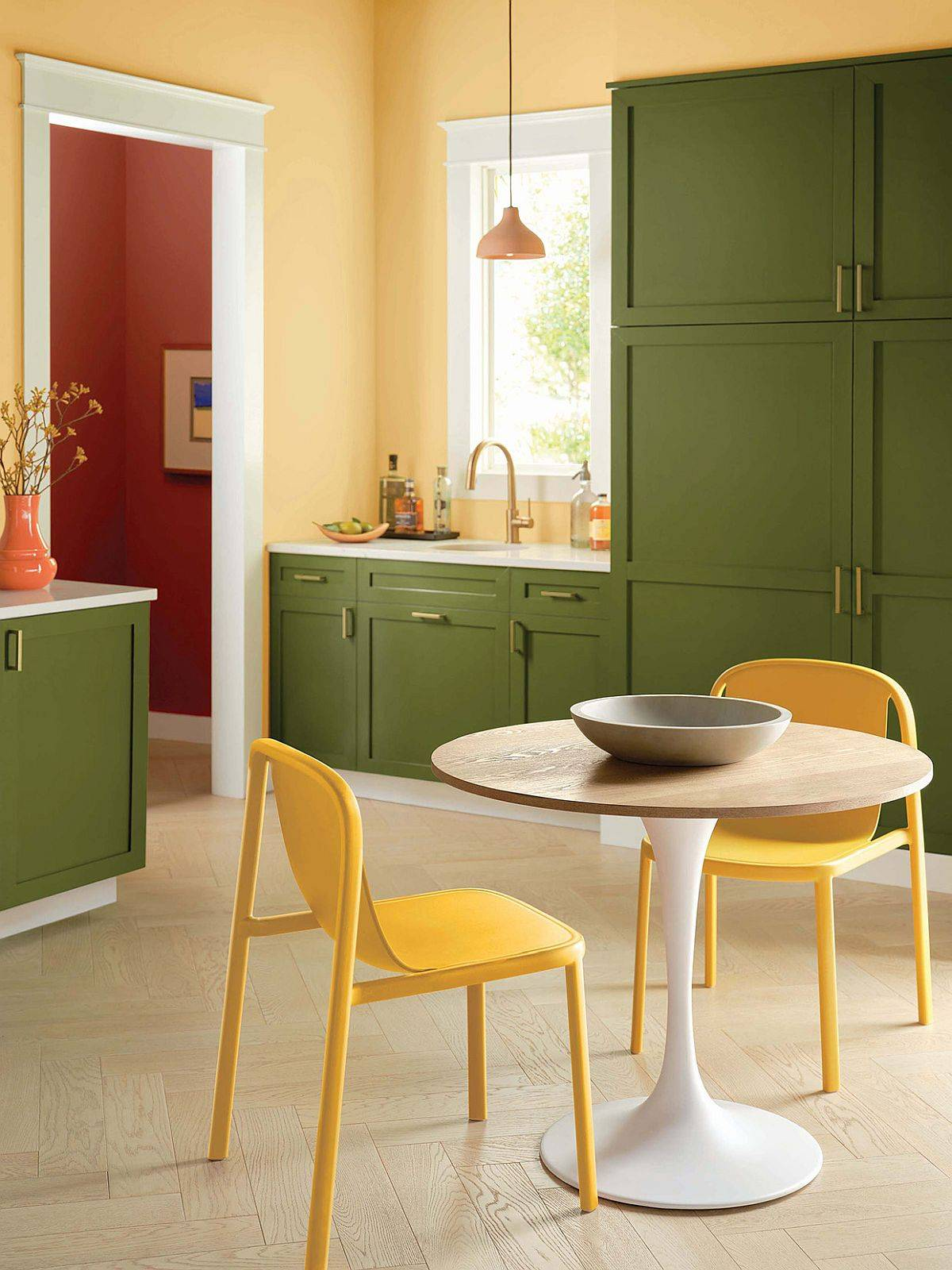 Gorgeous-green-cabinets-coupled-with-yellow-in-the-midcentury-modern-kitchen-with-a-pedastal-dining-table-83254