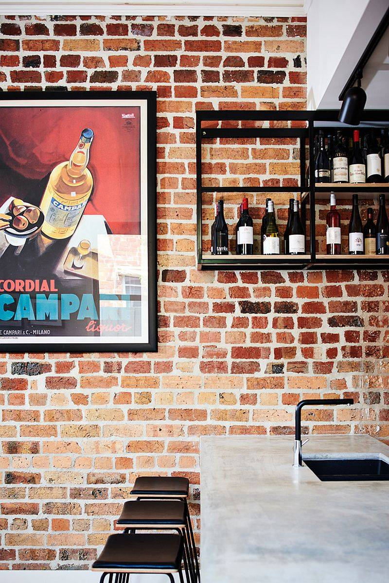 Gorgeous-suspended-wine-bar-with-an-exposed-brick-wall-in-the-backdrop-give-the-kitchen-a-wonderful-focal-point-46674