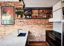 Kitchen-with-an-exposed-brick-wall-a-suspended-shelf-for-wine-collection-smart-island-and-eye-catching-wall-art-56413-217x155