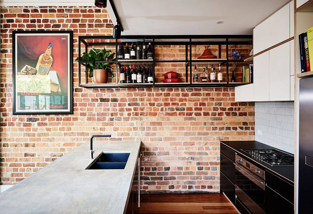 Kitchen-with-an-exposed-brick-wall-a-suspended-shelf-for-wine-collection-smart-island-and-eye-catching-wall-art-56413