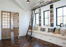 Large-built-in-bench-in-white-with-ample-drawer-space-and-bookshelves-all-around-is-a-great-addition-to-the-family-room-48877-217x155