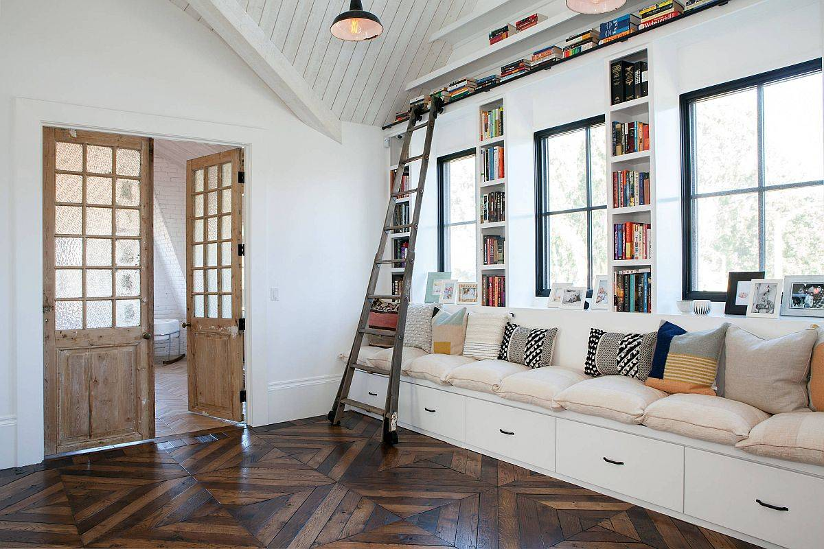 Large-built-in-bench-in-white-with-ample-drawer-space-and-bookshelves-all-around-is-a-great-addition-to-the-family-room-48877
