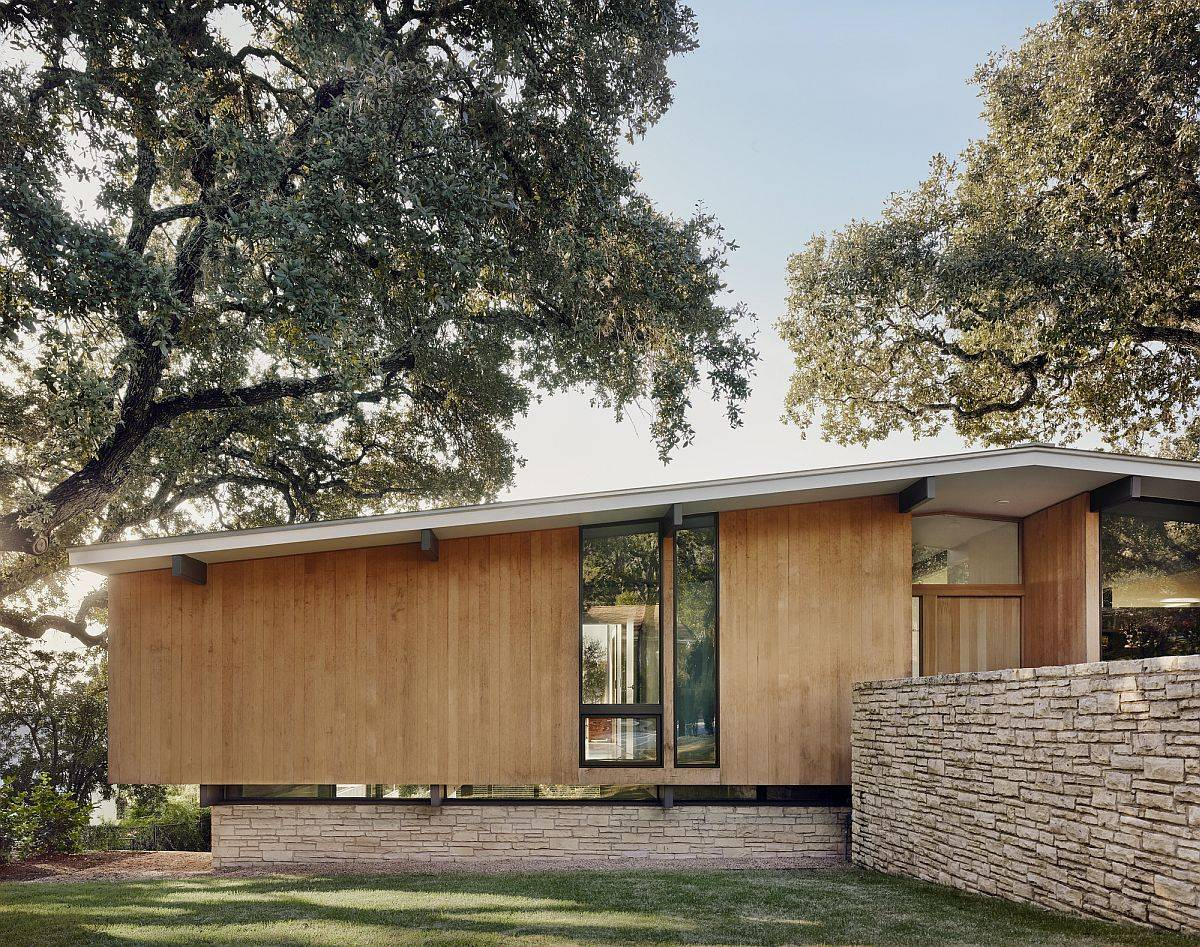Limestone base and pitched roof of the revamped modern Texas home