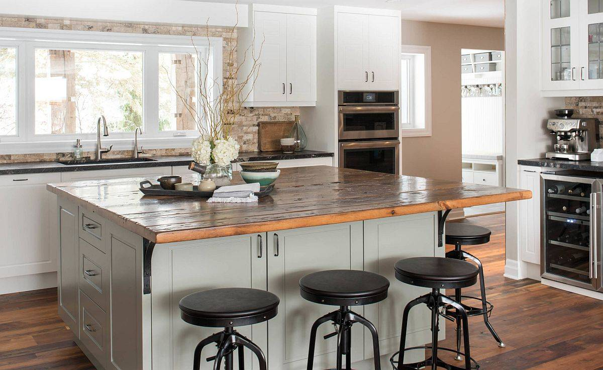 Little overhang of the kitchen countertop acts as a fun little breakfast bar