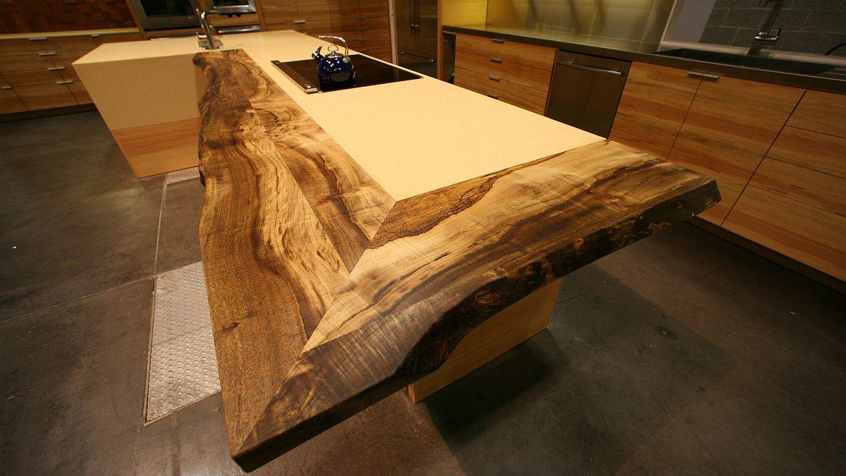 Live-edge-reclaimed-wood-counter-added-to-the-traditional-kitchen-island-in-an-eye-catching-manner-64758