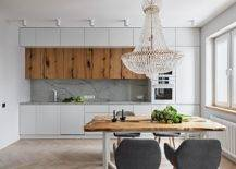 Live-edge-table-and-woodsy-cabinets-add-a-cozy-appeal-to-the-white-kitchen-51383-217x155