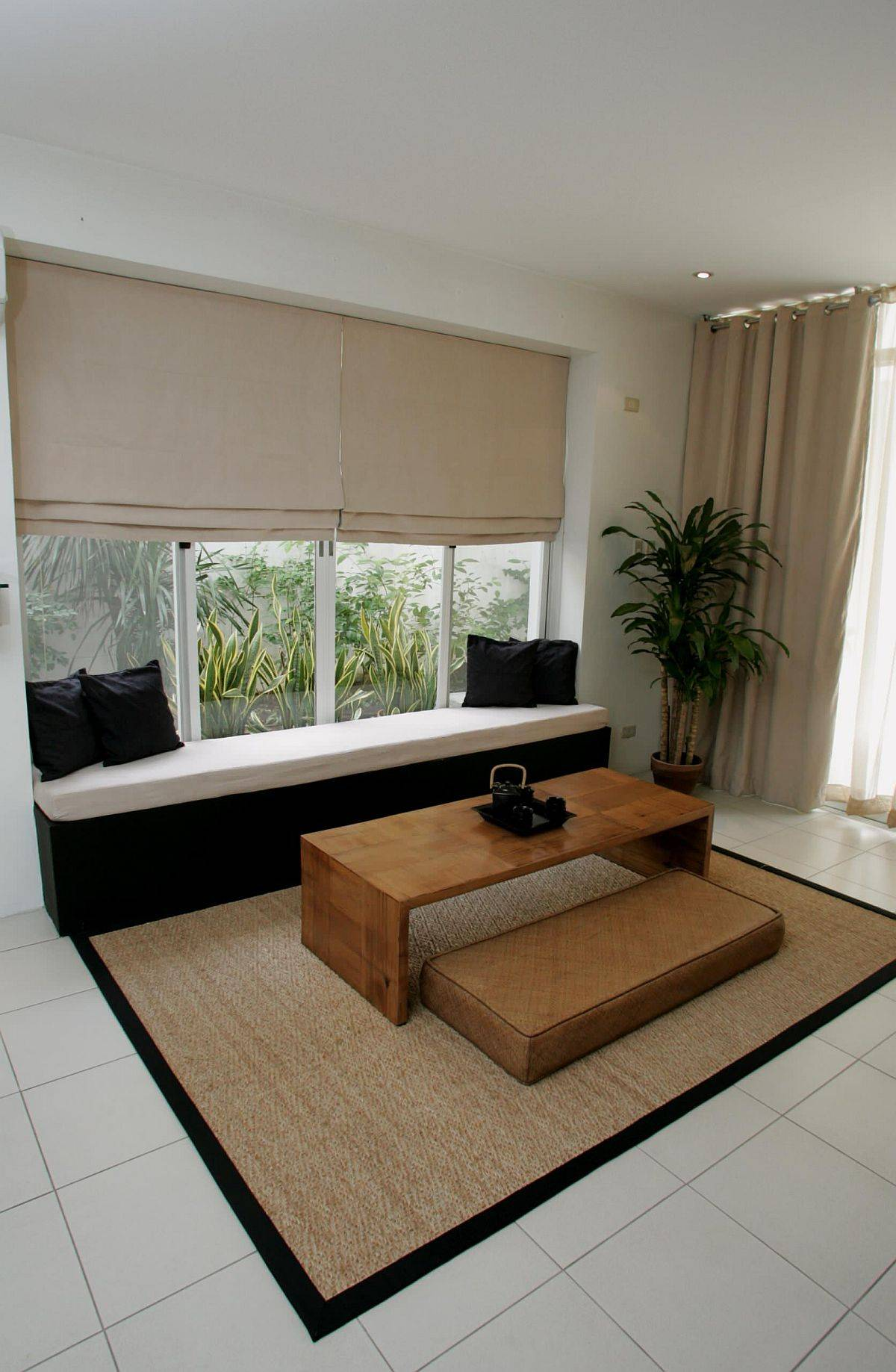 Mat-a-built-in-bench-and-minimal-decor-adorn-this-modern-yoga-space-in-a-living-room-17753