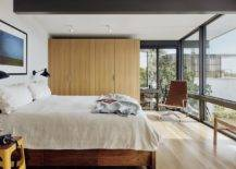 Modern-bedroom-with-oak-floors-white-walls-and-floor-to-ceiling-glass-walls-that-usher-in-natural-goodness-56214-217x155