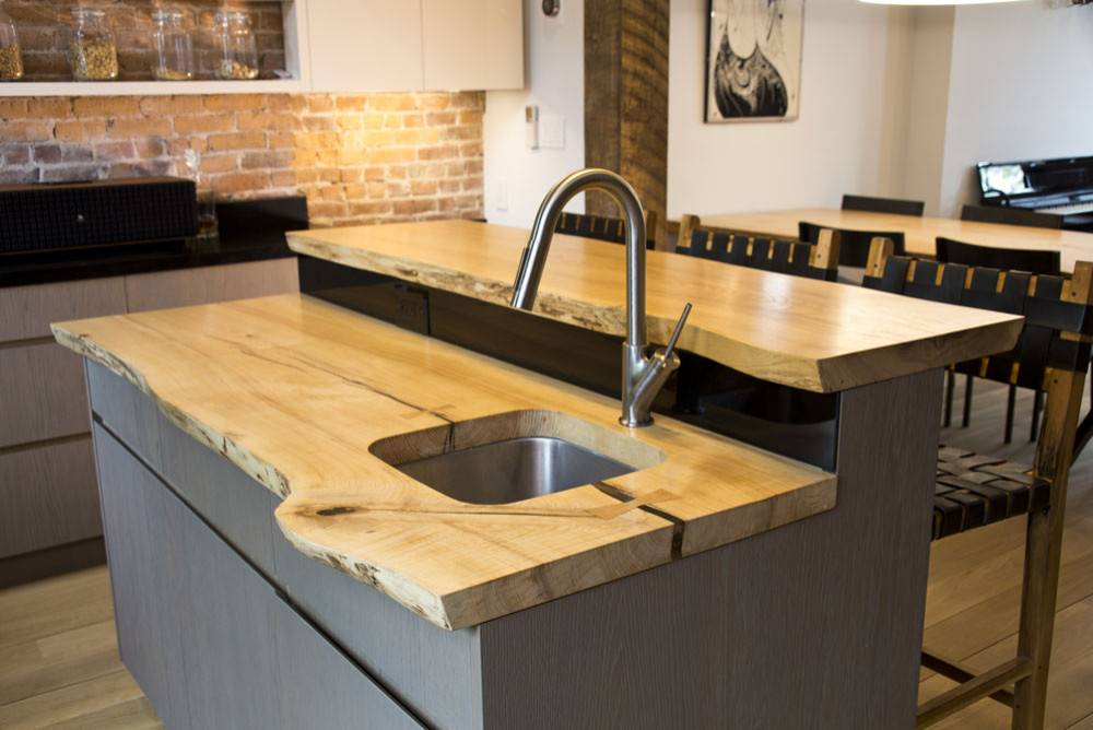 Multi-level-kitchen-island-with-counters-in-live-edge-wood-that-makes-ample-difference-76791