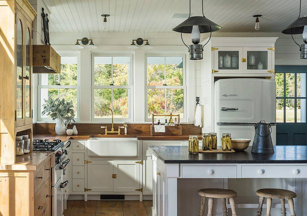 Natural light makes a big difference in this compact wood and white farmhouse style kitchen with modern touches