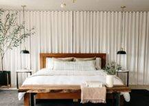 Naturel-edge-table-at-the-foot-of-the-bed-warm-textures-and-lovely-simple-backdrop-create-a-cozy-bedroom-80382-217x155