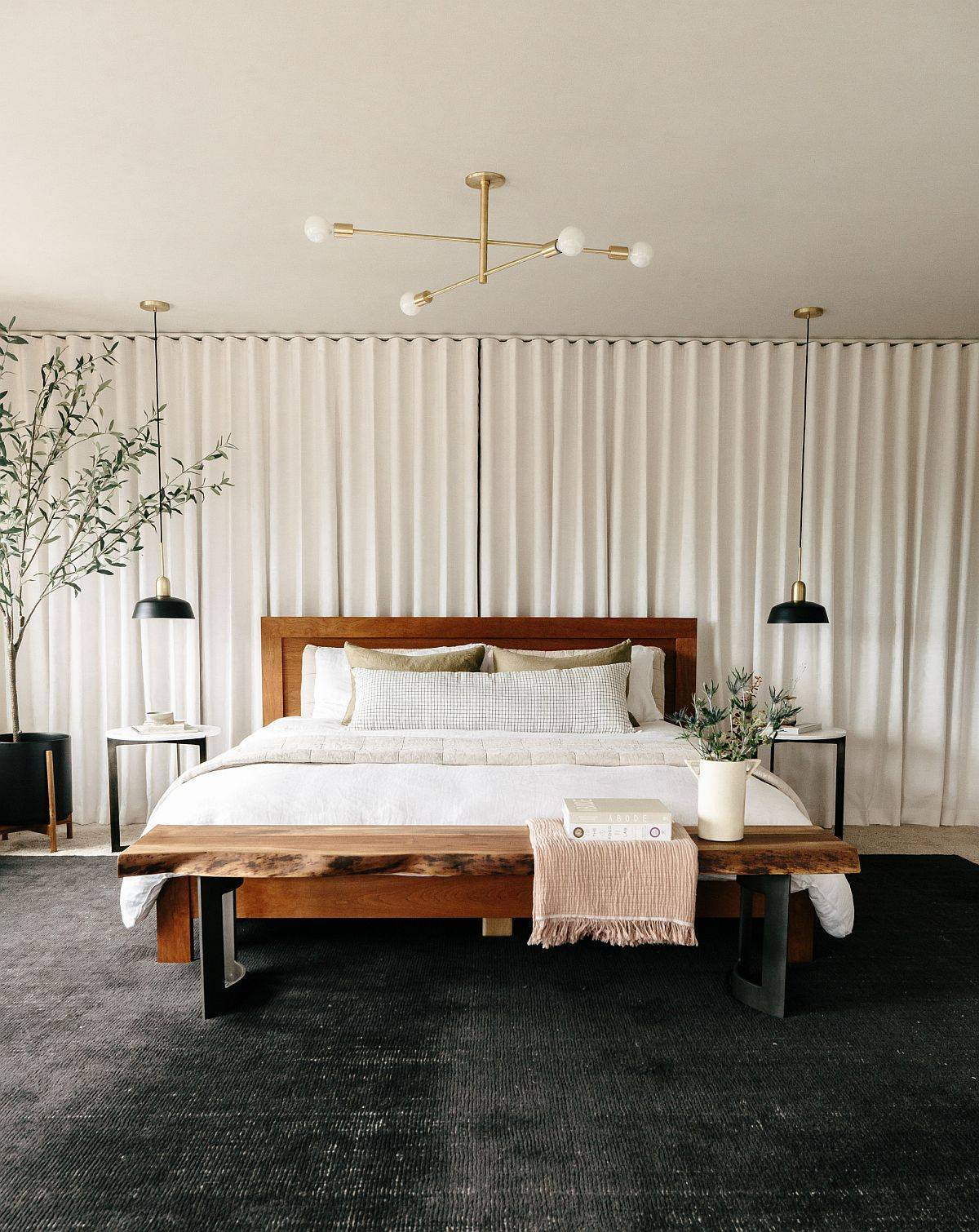 Naturel-edge-table-at-the-foot-of-the-bed-warm-textures-and-lovely-simple-backdrop-create-a-cozy-bedroom-80382