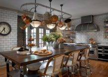 Pot-rack-coupled-with-lovely-lighting-above-the-dining-space-makes-a-statement-in-this-eat-in-kitchen-11945-217x155
