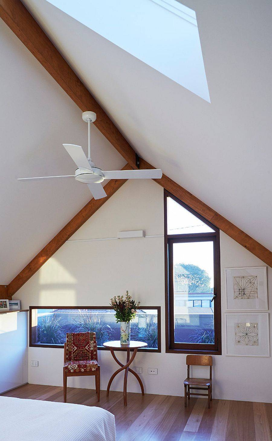 SKylight-brings-a-flood-of-natural-light-into-the-upper-level-bedroom-14943