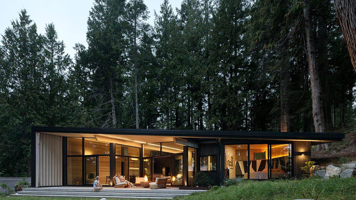 Series-of-lovely-glass-doors-and-floor-to-ceilig-glass-walls-conect-the-rear-facade-with-the-scenery-outside-74650