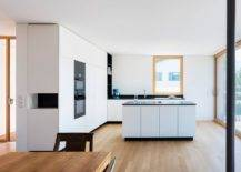 Sleek-contemporary-kitchen-in-white-with-wooden-floors-and-appliances-in-black-69116-217x155
