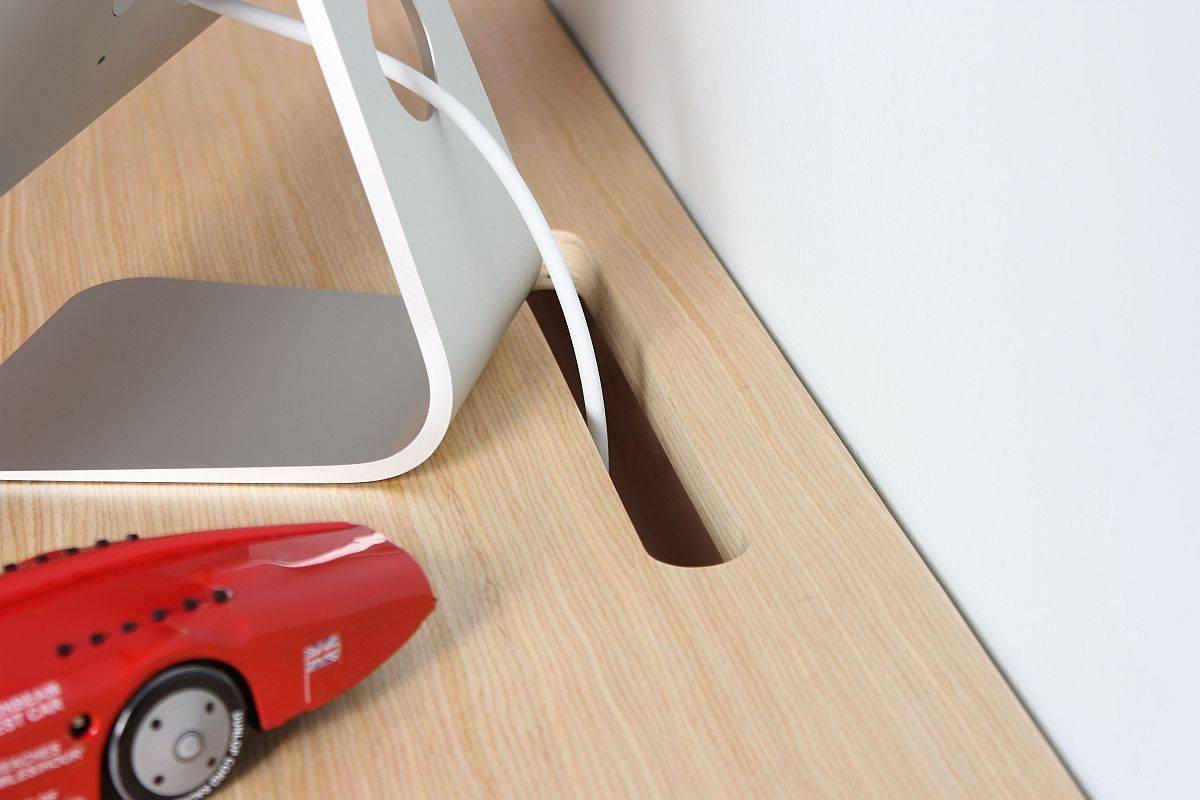 Slot-in-the-desk-design-offers-convenient-little-space-to-connect-wires-and-cords-53067