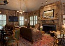 Small-and-cozy-rustic-living-room-with-wooden-walls-is-inspired-by-the-log-cabin-look-77323-217x155