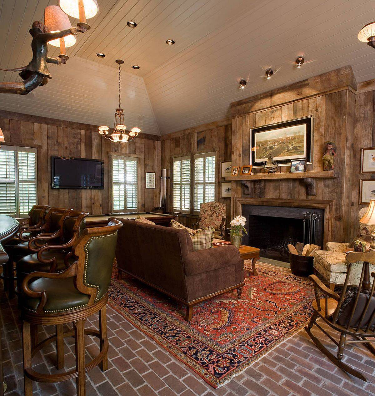 Small-and-cozy-rustic-living-room-with-wooden-walls-is-inspired-by-the-log-cabin-look-77323