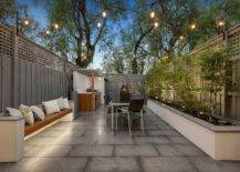 Smart-and-polished-contemporary-patio-with-a-lovely-built-in-bench-string-lights-and-greenery-45254-217x155