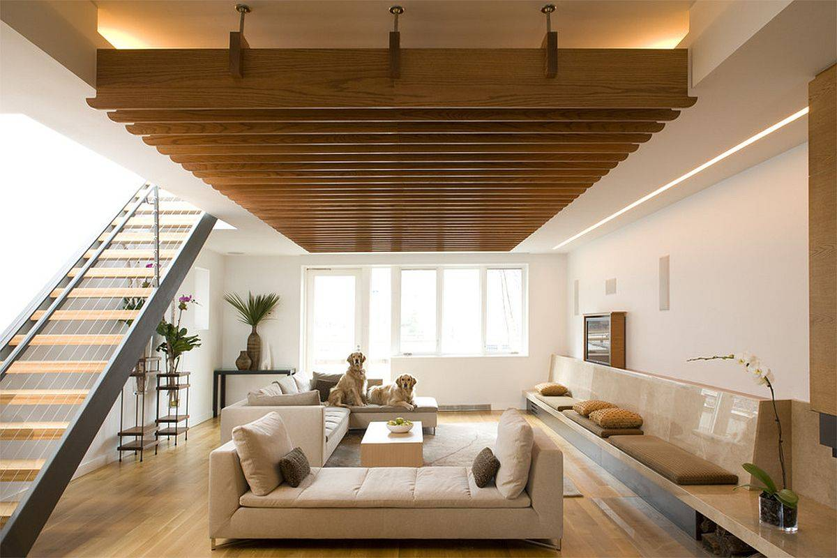 Smart-built-in-bench-of-the-family-room-in-stone-extends-the-length-of-the-room-86493