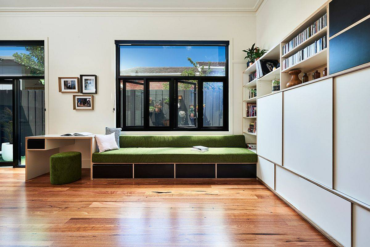 Spsce-savvy-built-in-bench-for-the-family-room-with-smart-workstating-next-to-it-19520