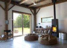 Stacked-firewood-and-modren-fireplace-bring-warmth-to-this-living-room-58109-217x155
