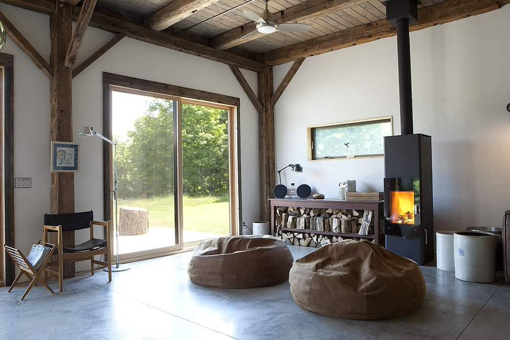 Stacked-firewood-and-modren-fireplace-bring-warmth-to-this-living-room-58109