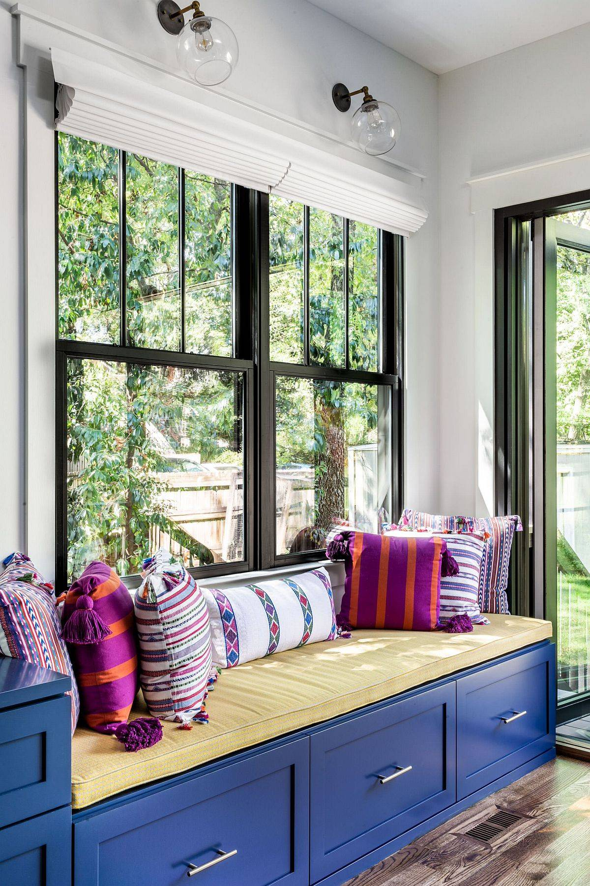 Tiny-built-in-bench-with-blue-drawers-and-a-comfortable-sitting-space-that-overlooks-the-garden-24307