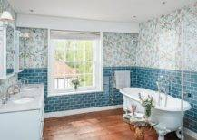 Vivacious-bathroom-with-wallpapered-backdrop-wooden-floor-and-marble-countertops-23562-217x155