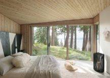 Wood-and-white-bedroom-of-th-Halfmoon-Bay-Cabin-with-striped-accent-wall-in-black-and-white-10523-217x155