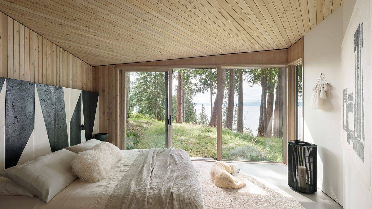 Wood-and-white-bedroom-of-th-Halfmoon-Bay-Cabin-with-striped-accent-wall-in-black-and-white-10523