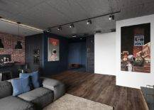 Wooden-floors-add-a-sense-of-warmth-to-an-apartment-clad-in-gray-and-black-with-decor-in-matching-hues-15832-217x155