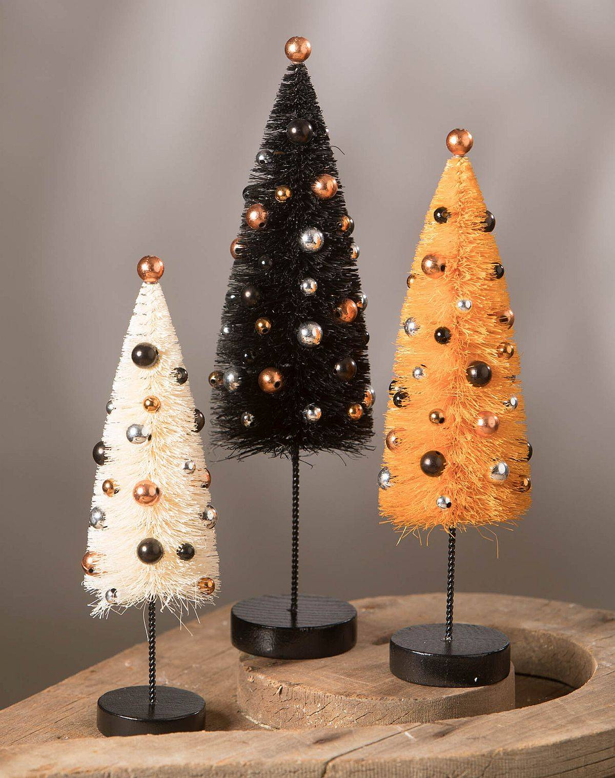 Exquisite black and orange trees are just perfect as decorative pieces for the Halloween dinner table
