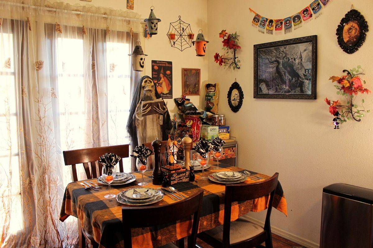 Halloween-themed kitchen decorations completely alter teh ambiance of this once cozy space