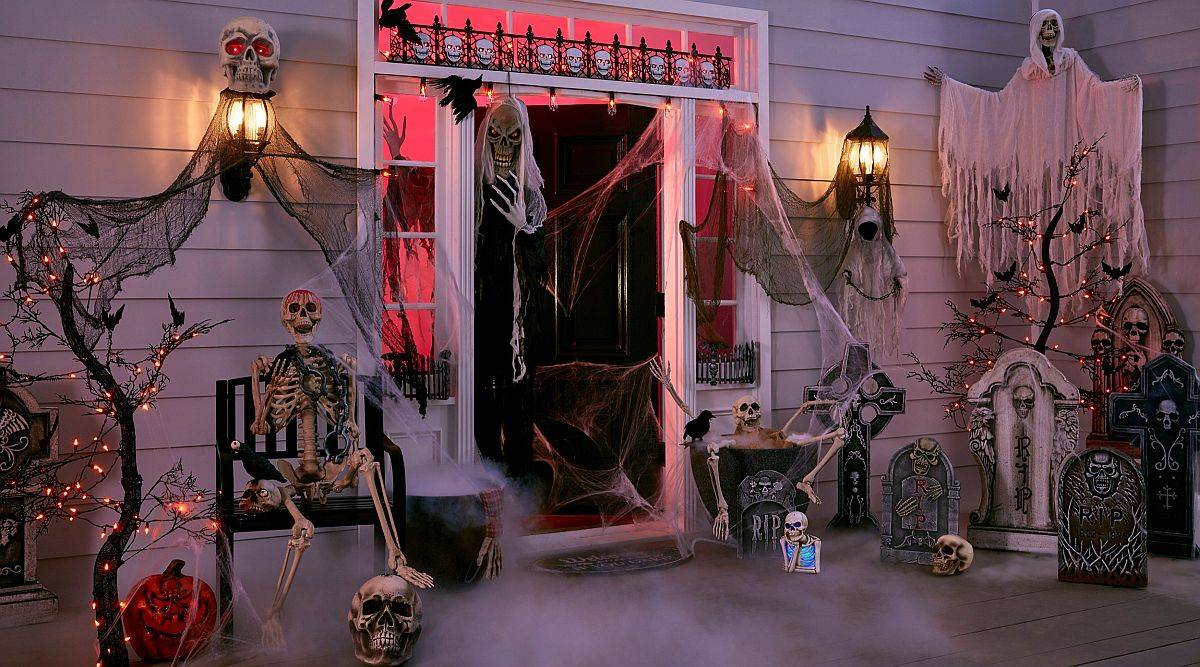 Porch that is ready to welcome guests on Halloween with a whole lot of spookiness!