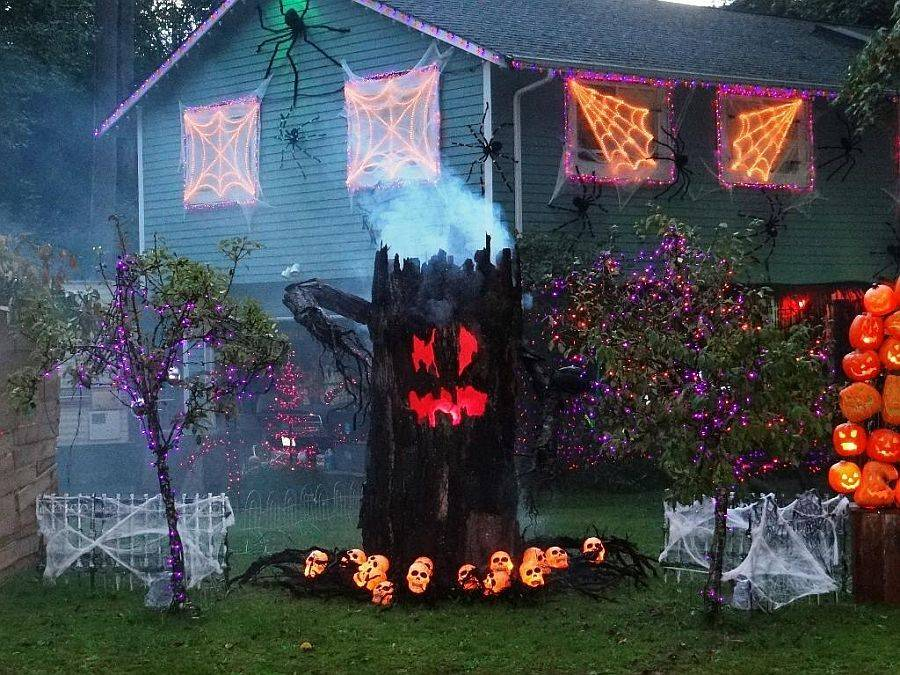 Spooky and unique Halloween front porch decorating idea that comes alive after dark!