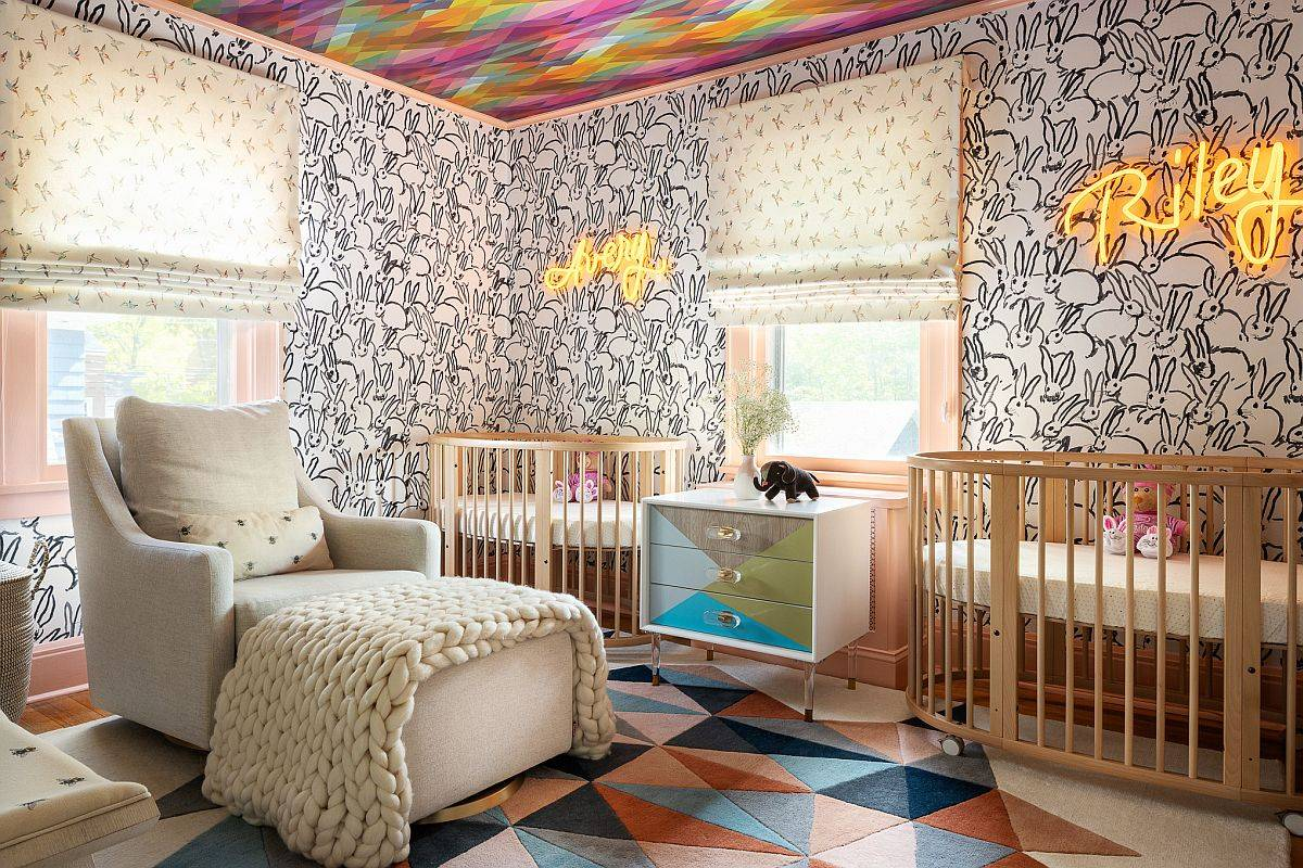 Stunning nursery for twins with multi-colored ceiling and walls lit up by illuminated signs