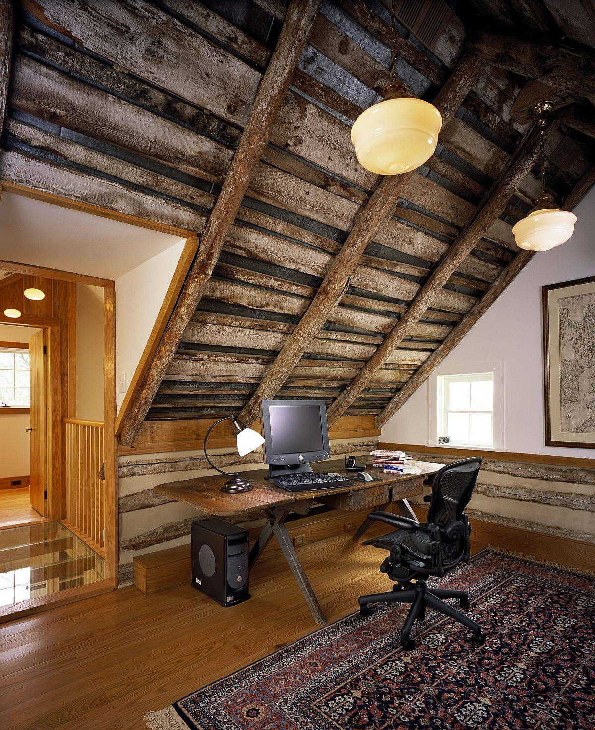 sloped-wooden-ceiling-of-the-attic-worksplace-is-just-perfect-for-the-small-rustic-office-48789